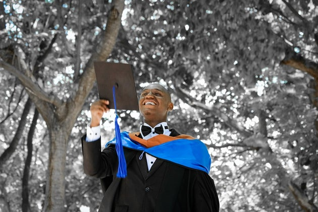 Man throwing his graduation cap in the air