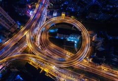 Overhead photo of a multi-level highway at night.