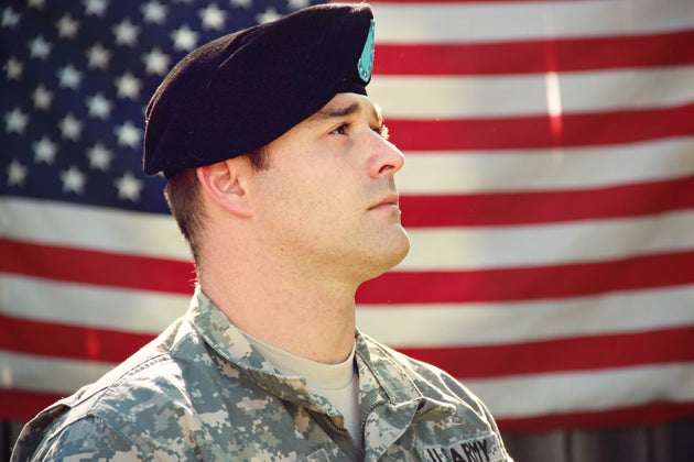 Soldier with American flag in the background