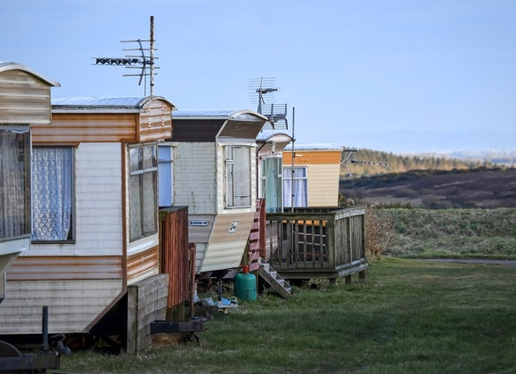 Row of five single-wide mobile homes.