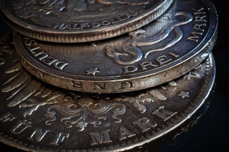 Closeup of three vintage coins