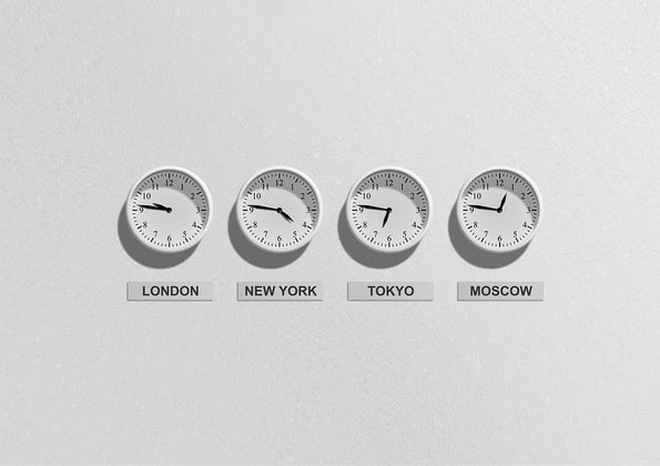 Clocks showing the time in different cities