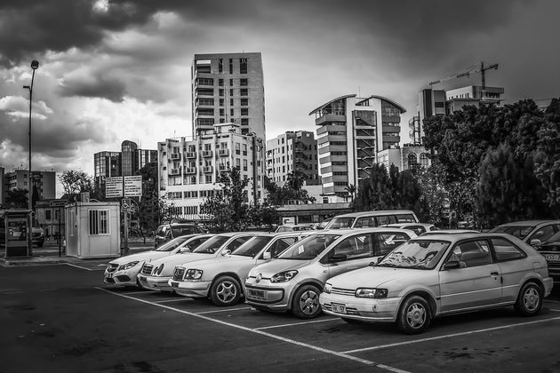 Cars lined up in a parking lot